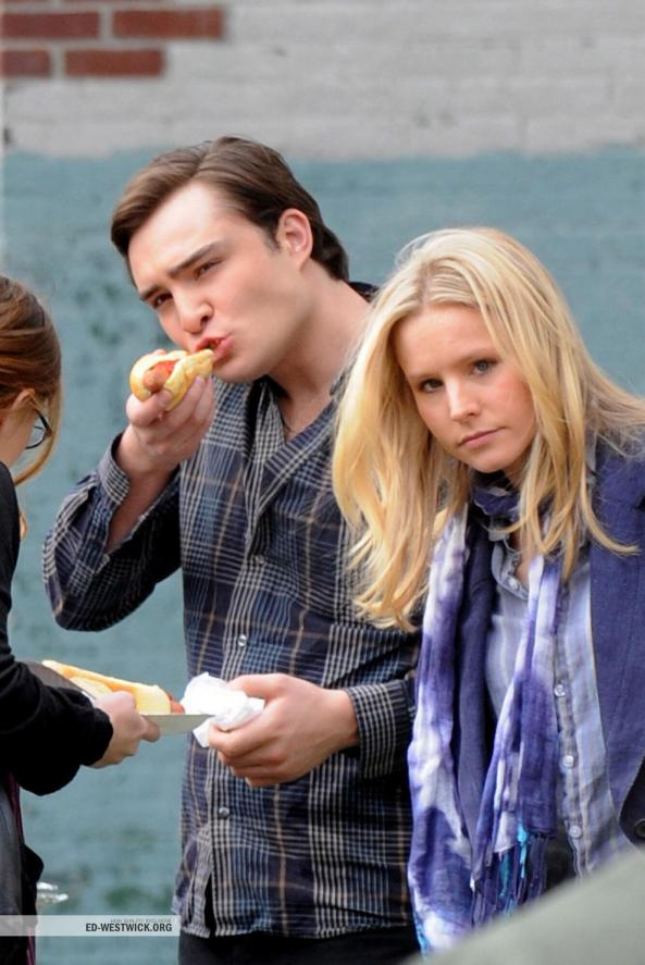 Ed Westwick enjoys a hot dog on the set of Gossip Girl